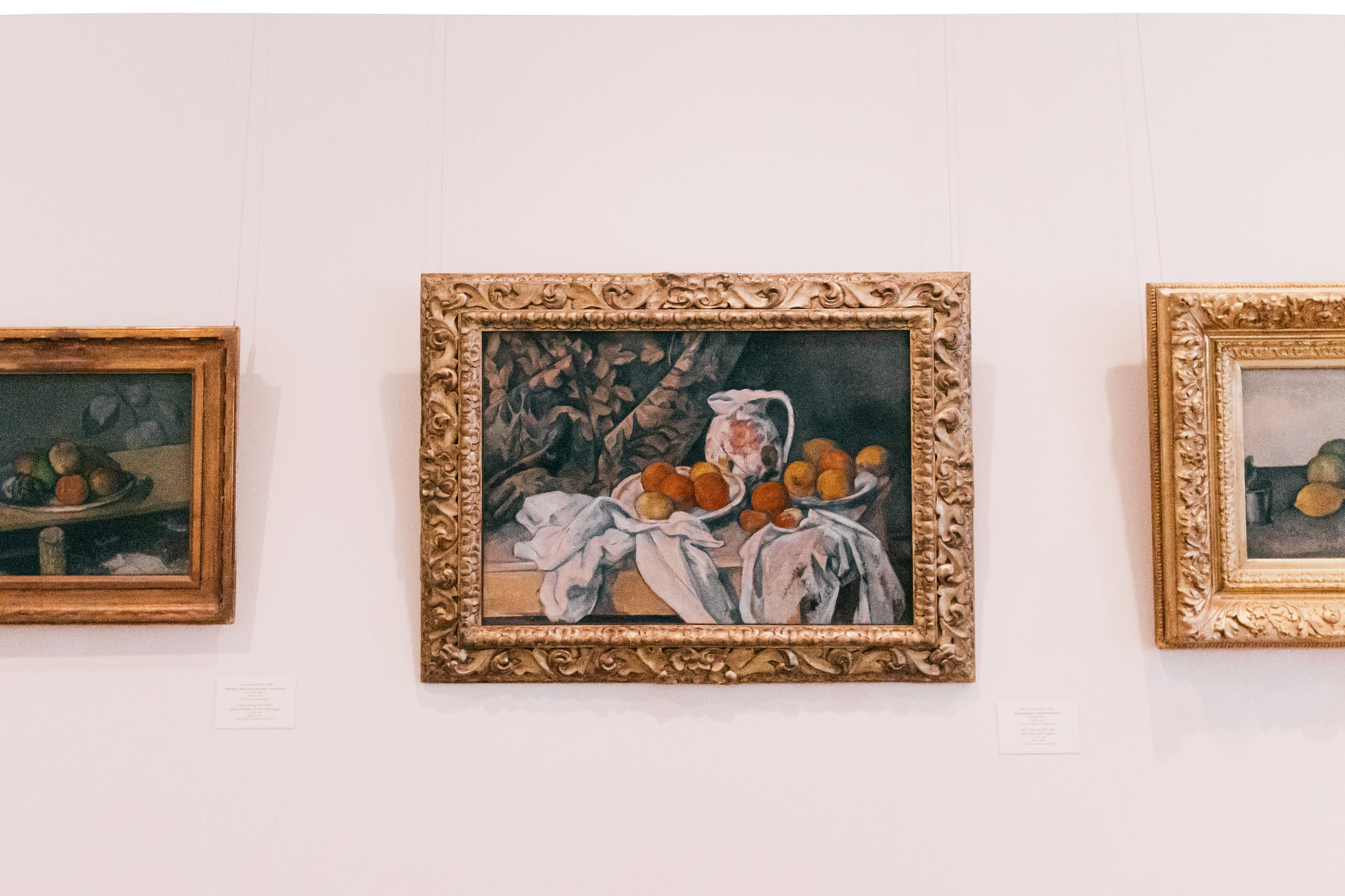 brown wooden framed painting on a wall